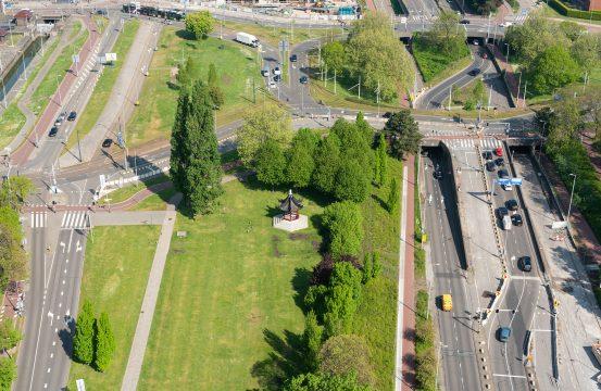 Rotterdam, Netherlands - April 29, 2019 : Het Dam Paviljoen in Parkhaven surrounded by roads aerial view